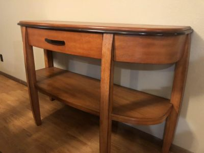 Dining table with 6 chairs and matching consulate table.