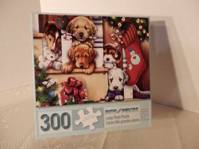 "300 large piece puzzle. ""Christmas Puppies On The Loose"""
