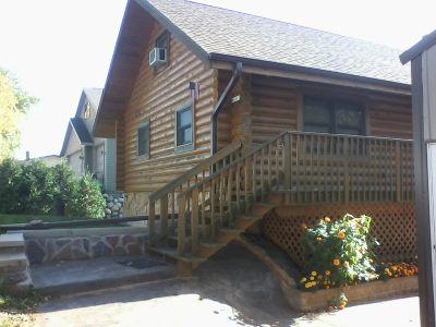 Beautiful log cabin on river $230,000