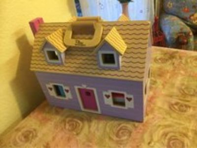 Adorable little carrier doll house