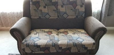 Convertible sofa/loveseat with storage.