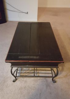 Red trim, metal base coffee table, with compartments