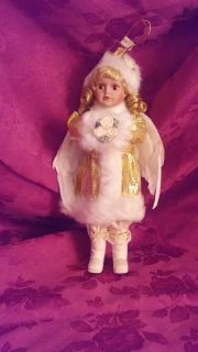 Holiday dressed angel doll ornament