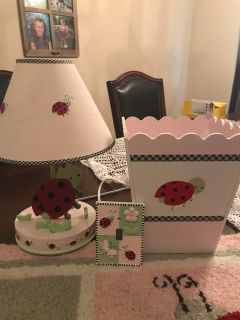 Ladybug lamp, trash can, light switch cover and rug