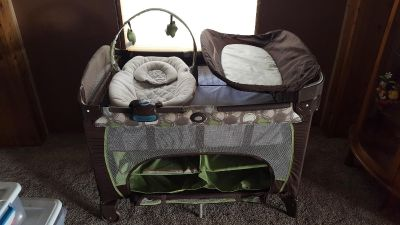 Graco PacknPlay with Infant Sleeper and Changing Table and Storage