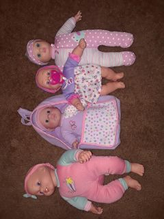 4 baby dolls and accessories