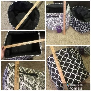 Set of 2 black and white canvas storage bins, each one measures 13 inches tall, 15 inches wide, both in GUC with very light wear. $6.00