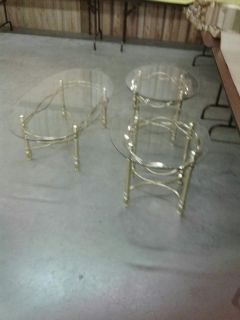 Beutifull glass an brass coffee table and end tables