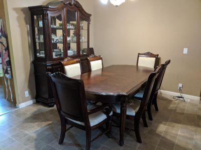 Broyhill Hutch and matching table seats 8