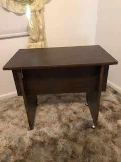 Table with wheels. MUST COME PICK UP.