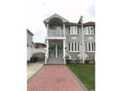 Bayside Real Estate Rental - Three BR, Two BA Apartment in house