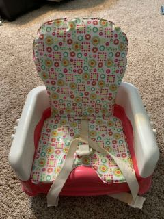 Height Adjustable booster seat.