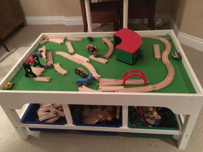Wooden train table and all trains and tracks