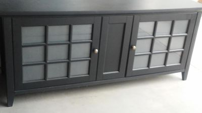 """Dark wood TV cabinet 2 doors & 3 shelves in each side, 5ft. Wide 26"""" tall & 20""""deepvery nice condition, selling for my mom she is asking $75"""