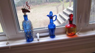 Decanters & bottle- in lovelyu colours to catch the sunlight
