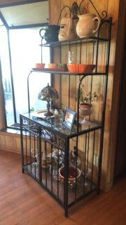 Bronze metal bakers rack with 4 glass shelves and wine and glass rack