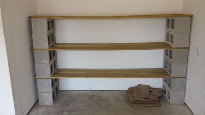 Garage shelving. Included 16 cinder blocks and 6 boards 1x4's.