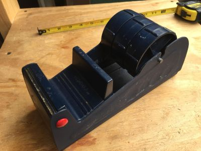 3 wide table tape dispenser. For three 1 rolls or one 2 and 1 roll. Used. Works great.