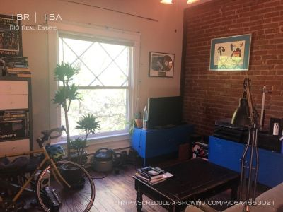 Stunning Top Floor 1BR plus Den with Exposed Brick!
