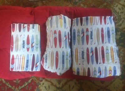Red Queen size down comforter/Tommy Hilfiger queen sheet sets. Very good condition. Pet & smoke free home. All for $25