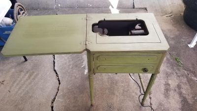 Antique sewing machine table
