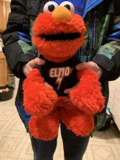 Elmo doll sings and plays music