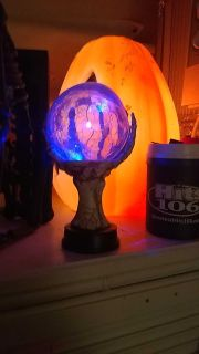 Halloween glass Ball held up by a hand