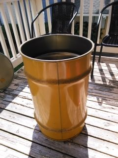 Steel storage drum with lid and strap that locks