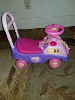 Disney pink sit and ride
