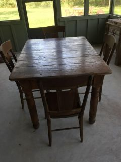 Great rustic farmhouse table with 4 chairs-52 x 39 -1 chair has a leather seat-see more pictures for tabletop and leather chair
