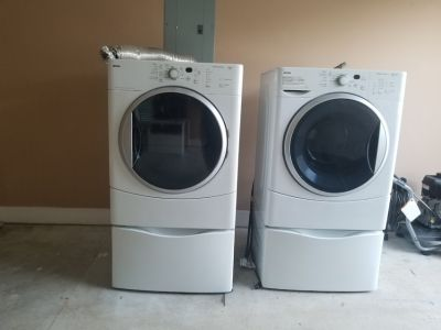 Kenmore Washer and Dryer with stand