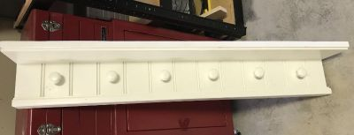 Pottery Barn white wooden shelf w/hooks. 40 long x 6-1/2 wide (shelf). Bead board design, very sturdy! Moved, bought but cannot use!