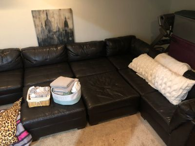 Black leather 8 piece sectional from American Furniture Warehouse