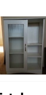 White cabinet with glass door and adjustable shelves
