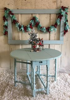 Round antique Table- watery