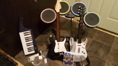 Rock Band 3 game and 2 guitars plus Keyboard and Drums and mic