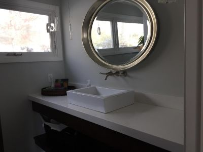 Large, silver-framed, oval mirror