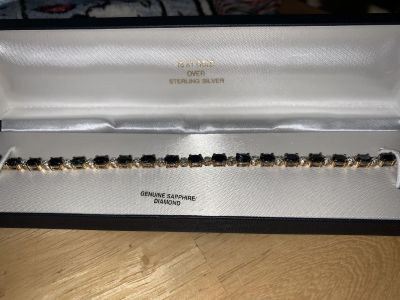 Pick up Tuesday for $25. New in Box Diamond and Sapphire Bracelet