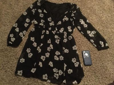 Cute, black V neck women s dress with tan flowers and elastic tapered waistline, in VGUC, shorter dress or long tunic. $5.00 size Large