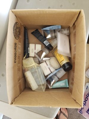 Box of Unused Shampoo/Conditioner, Body Wash, and Lotion Samples