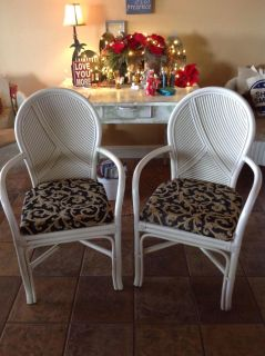 A pair of bamboo chairs with removable phone covered platform cushions