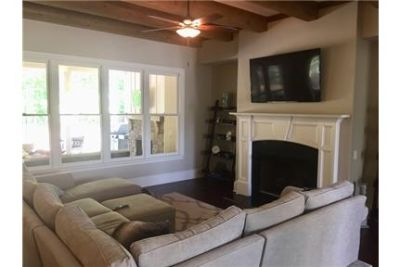 5 bath traditional style home with optional 4th bedroom/bonus room on level lot. Natural stone patio