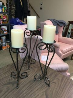 Three metal candle holders w candles