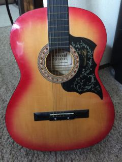 Universal guitar New string n tuned $30 excellent for beginner also has outlet to plug in to a speaker.