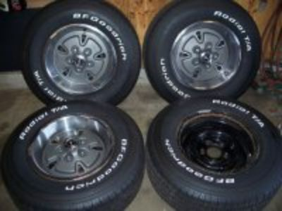 "Rare Ford factory 14"" wheels,covers and tires"