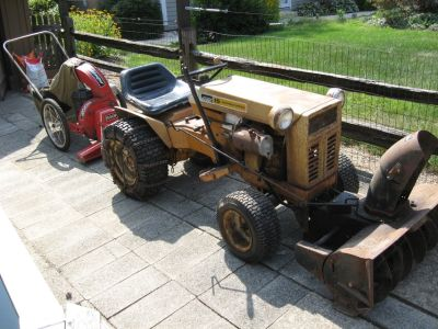 15 HP Montgomery Ward Tractor and attachments.