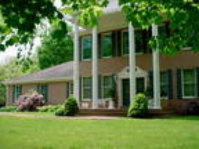 Grand One Owner Home on 5 Wooded Acres with Pond!