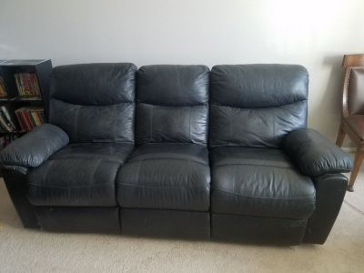 Black leather reclining couch