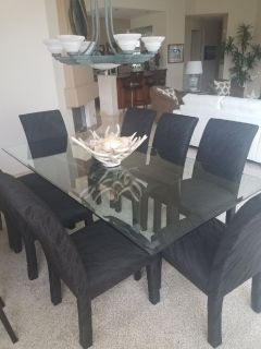 Glass dining room table and 8 chairs