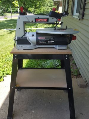 Scrolling saw with table